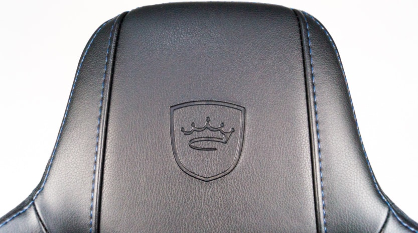 Crown emblem on headrest