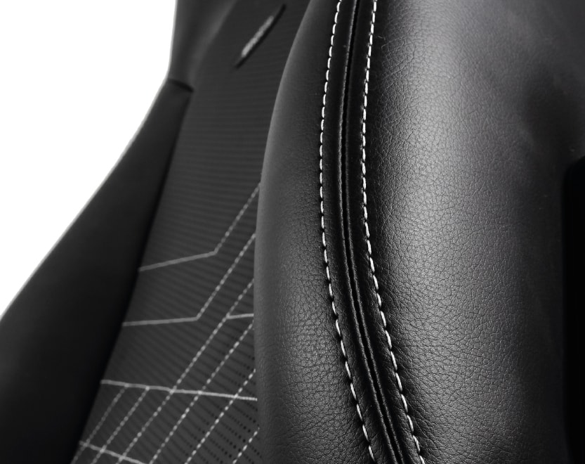 Leather cover of the ICON's backrest in black and white